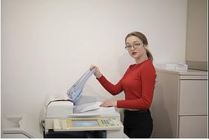 a lady using a printer